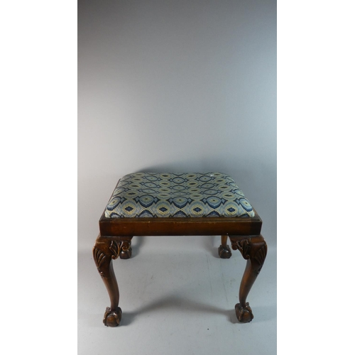 37 - An Edwardian Walnut Framed Rectangular Stool with Cabriole Legs and Claw and Ball Feet, 58cm Long...