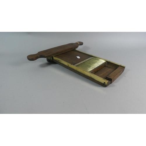 17 - A Victorian Brass Mounted and Wooden Pill Maker...