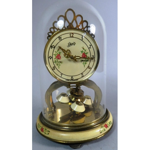 51 - A Mid 20th Century Schatz Pillar Clock Under Plastic Dome, 20cm High...
