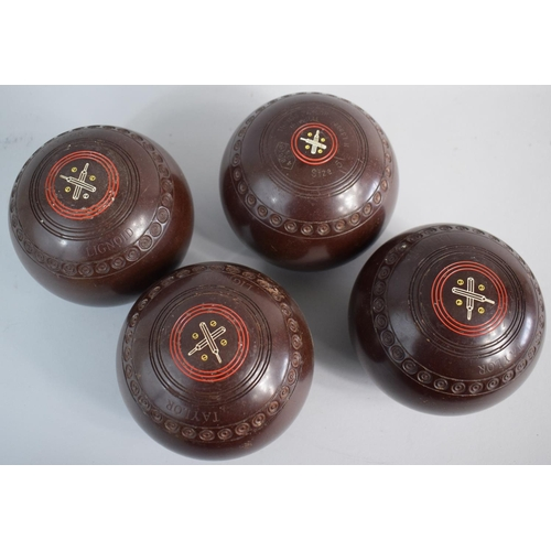 58 - A Set of Four Matching Lawn Bowls. Size Five, Thomas Taylor, Lignoid...