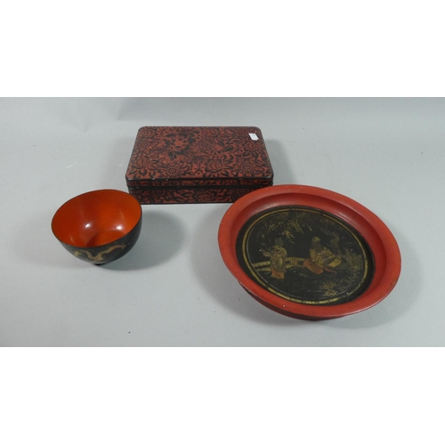 54 - A Lacquered Oriental Papier Mache Rectangular Box Together with a Circular Tray and Bowl...