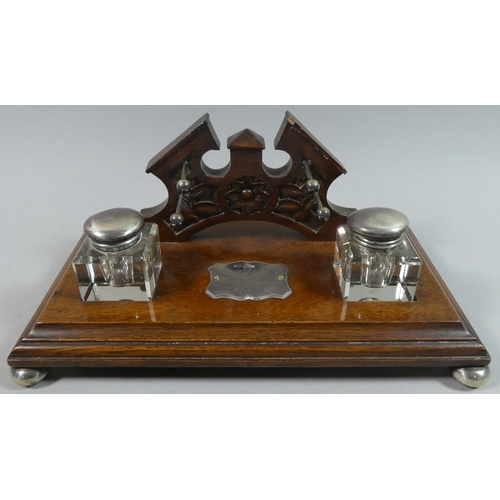 28 - An Edwardian Oak Presentation Desktop Ink Stand with Two Silver Topped Inkwells and a Silver Escutch...