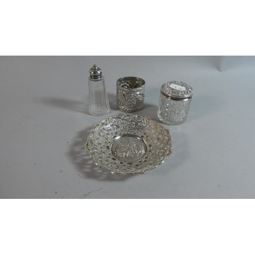 13 - A Silver Topped Glass Pepper Pot, Silver Topped Glass Dressing Table Pot, Silver Plated Napkin and P...