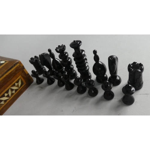 2 - An Indian Inlaid Box Containing Miniature Chess Pieces...