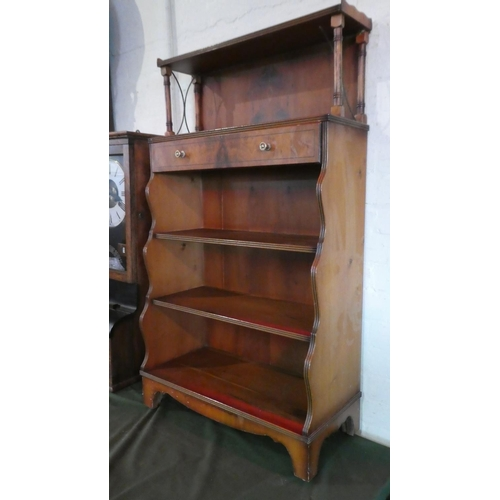 25 - A Reproduction Waterfall Bookcase with Galleried Top, Single Long Drawer, Three Shelves Under, 61cm ...