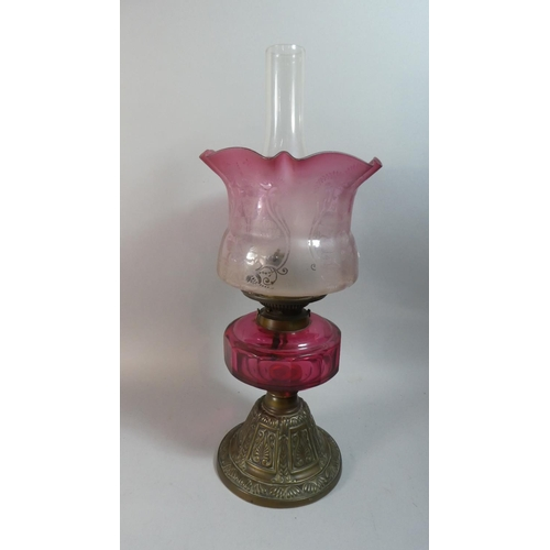 30 - A Late Victorian Brass Based Oil Lamp With Cranberry Glass Reservoir, Hinks Duplex Controls and Etch...