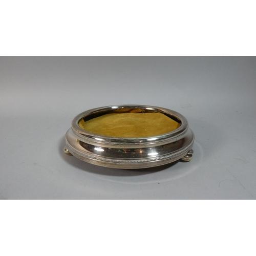 37 - A Circular Silver Plated Coaster on Three Bun Feet, 20cm Diameter...