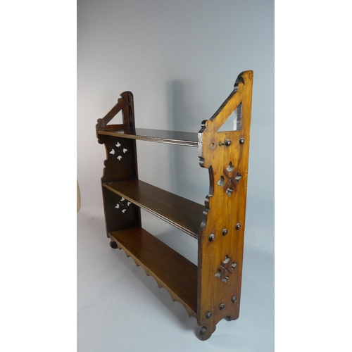44 - A Late Victorian Wall Mounting Three Tier Shelf Unit with Pierced Sides, 58cm Wide...