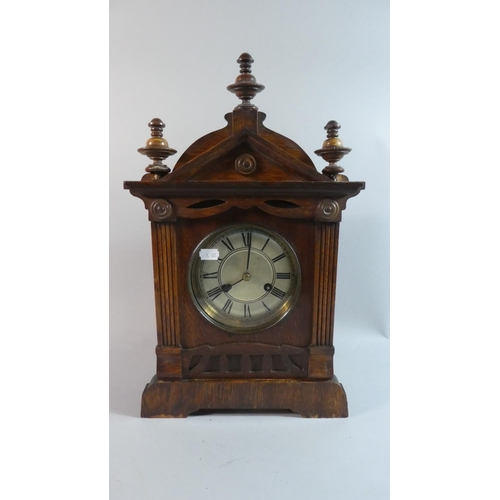 47 - An Edwardian Oak American Mantle Clock of Architectural Form, 45cm high...