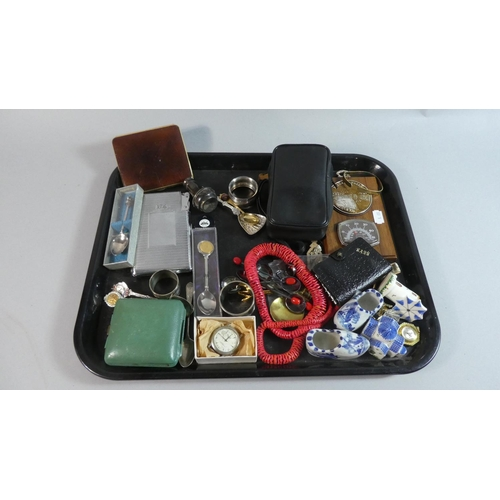60 - A Tray of Curios to Include Souvenir Spoons, Travelling Alarm Clock, Cigarette Case/Lighter, Folding...