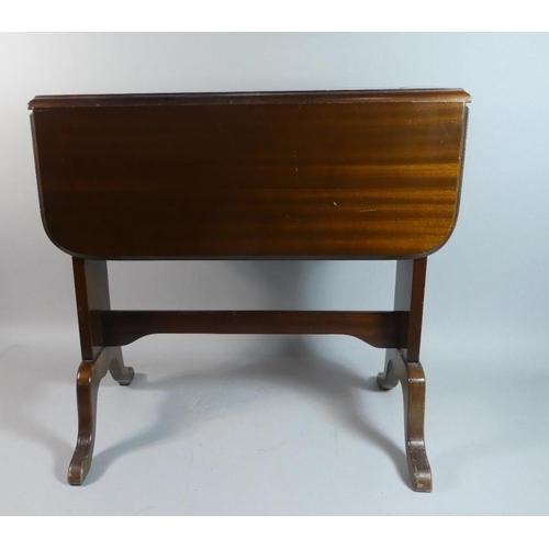46 - An Edwardian Mahogany Drop Leaf Sutherland Table...