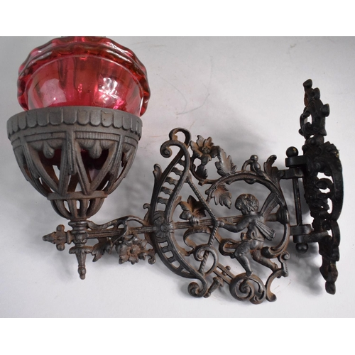 15 - A Victorian Pierced Metal Wall Mounting Oil Lamp Holder Complete with Lamp Having Cranberry Glass Re...