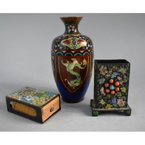 17 - A Small Oriental Cloisonne Vase, a Small Cloisonne Match Box Holder and a Similar Desk Top Match Box...