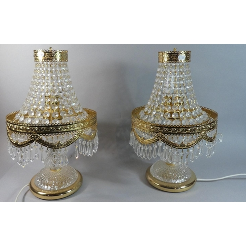 19 - A Pair of Ornate and Gilt Crystal Table Lamps. Each 50cm high...