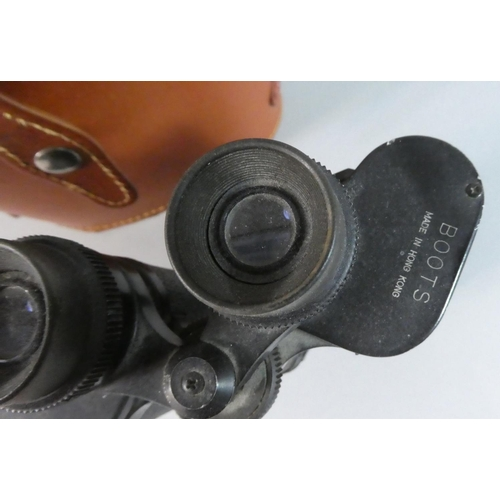 27 - A Pair of Leather Cased Binoculars...
