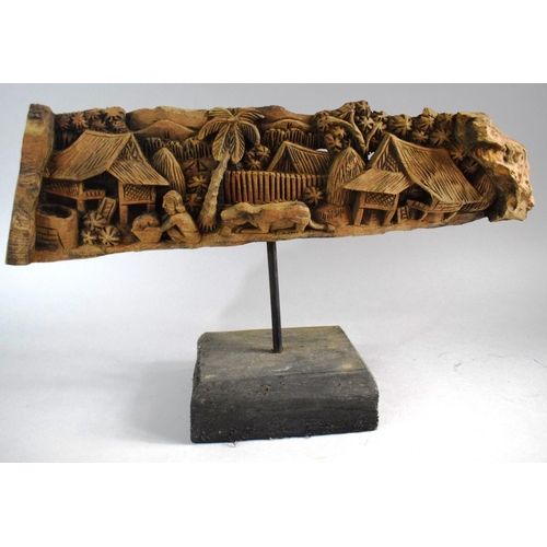 43 - A Indonesian Carved Wooden Study of Coastal Village Scene with Figure, Water Buffalo and Coconut Pal...