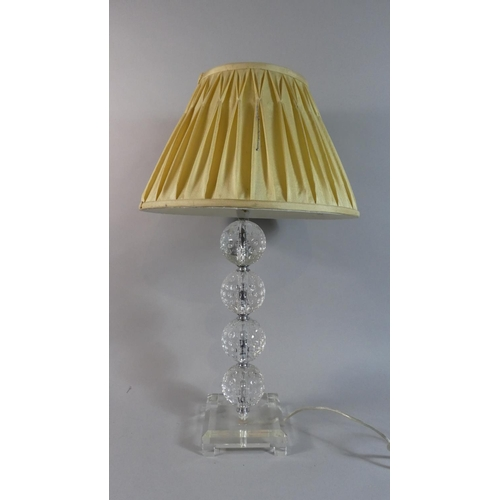 48 - A Modern Chrome and Glass Table Lamp and Shade with the Support in the Form of Four Golf Balls, 61cm...