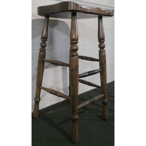 53 - A 20th Century Kitchen Bar Stool with Carved Shaped Seat and Turned Supports, 75cm high...
