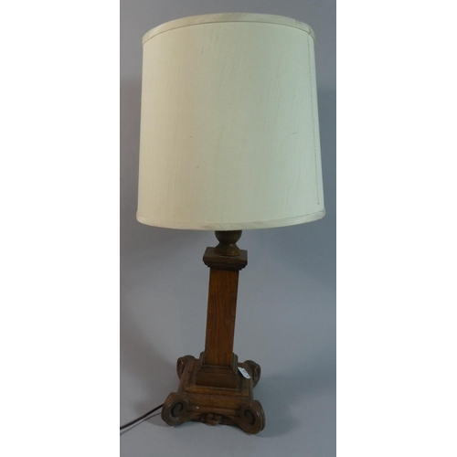 57 - An Edwardian Oak Table Lamp with Scrolled Square Plinth Base...