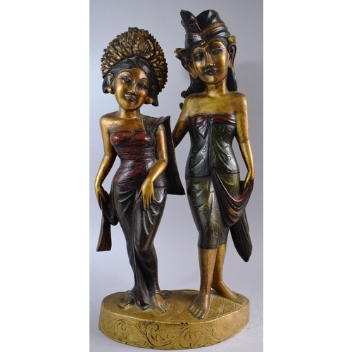 46 - A Carved Wooden Balinese Figure Group Depicting Ladies, 53cm High...
