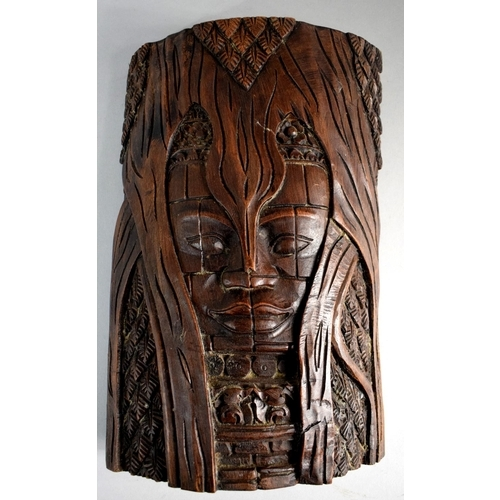 58 - A Carved Far Eastern Wall Hanging Depicting Mask in Tree, 30cm High...