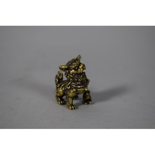 48 - A Small Chinese Bronze Study of a Foo Dog, 3cm High...