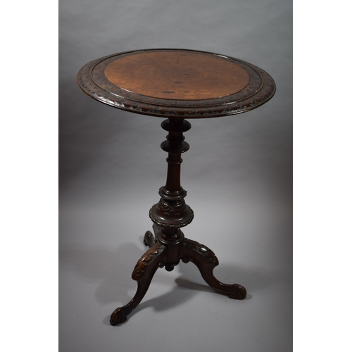 21 - A Victorian Circular Burr Walnut Topped Tripod Table with Carved Border and Acanthus Detail to Suppo...