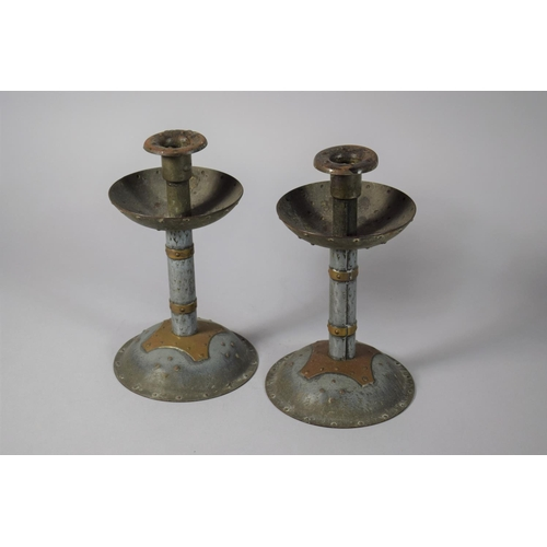 55 - A Pair of Arts and Crafts Copper Mounted Metal Candlesticks with Faux Rivet Decoration, 22cms High...