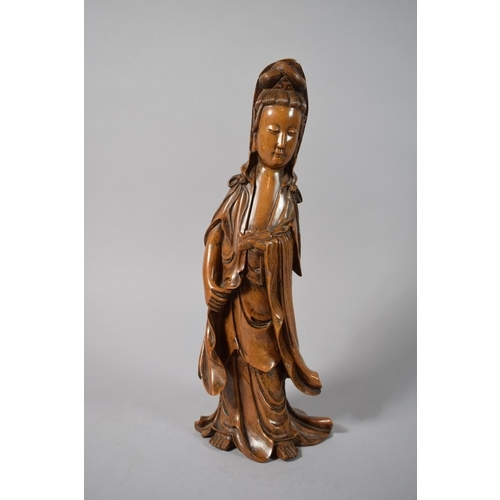 28 - A Chinese Carved Hardwood Figure of Guanyin, 39cms High...