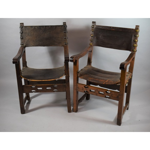24 - A Near Pair of 18th Century Spanish Armchairs with Pierced Front Rails, Leather Sling Backs and Seat...