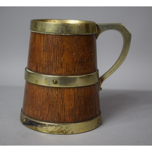 17 - A Late 19th Century Coopered and Banded Tankard, 11cms High...