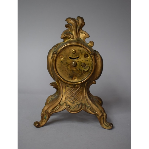 22 - A French Gilt Metal Mantel Clock with Moulded and Pierced Decoration, 16cms High...