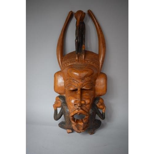 51 - A Large Carved Wooden African Tribal Souvenir Mask, Hear No Evil, See No Evil, Speak No Evil. 75cms ...