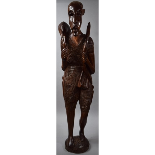 52 - A Large Modern Carved Wooden African Figure of Huntsman with Bow Carrying Antelope, 98cms High...