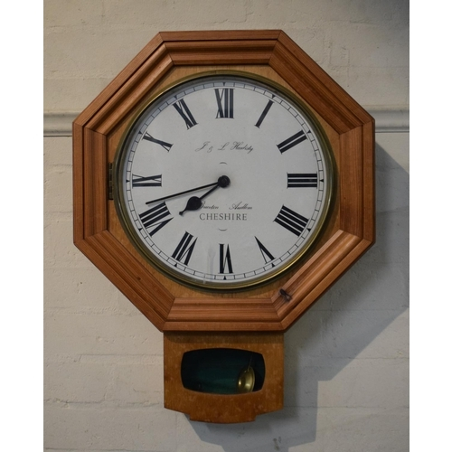 19 - A Pine Framed Octagonal Enamelled Faced Wall Clock by J&L Hardisty, Buerton Audlem, Cheshire...