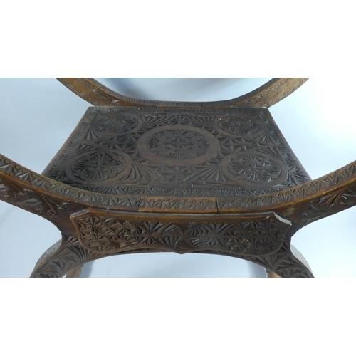 18 - An Edwardian Carved Wood X Frame Stool, 60cms Wide...