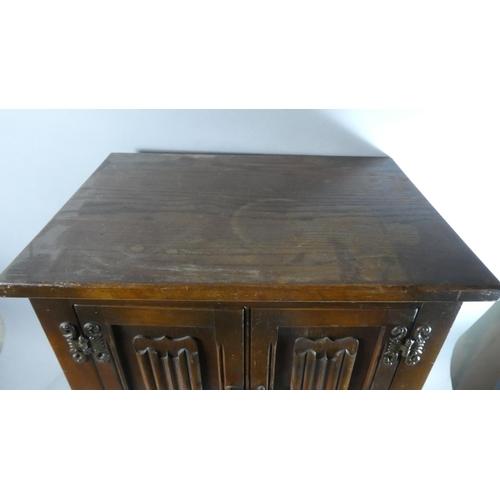 49 - An Oak Linenfold Small Cupboard, 50cms Wide...
