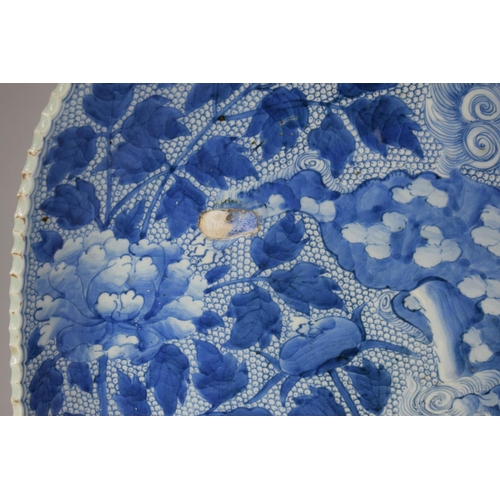 241 - A Large Edo Period (1615-1868) Japanese Blue and White Square Plate Decorated with Stalking Lion in ...