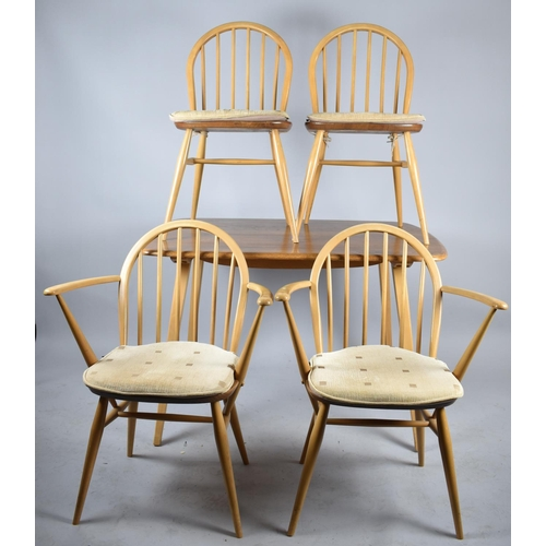 485 - An Ercol Rectangular Dining Table and Four Hooped Spindle Backed Chairs...