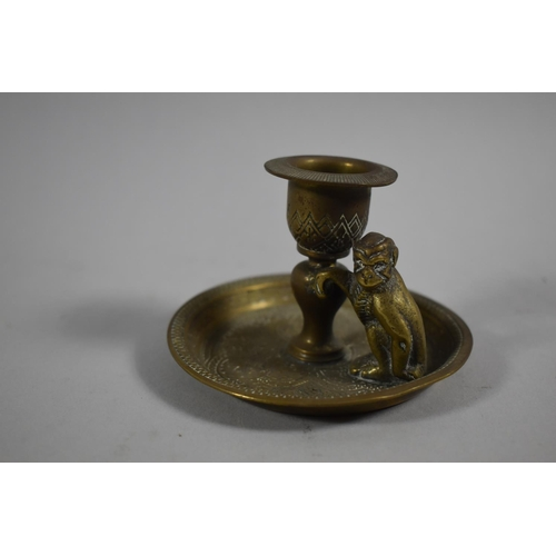 15 - A Small Brass Candlestick with Monkey Mount by Kinco, England, 9cm Diameter...