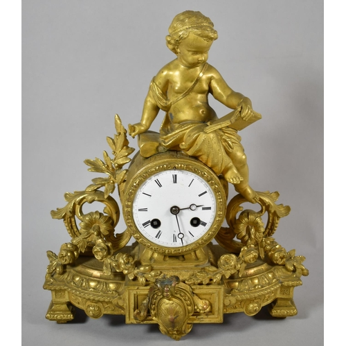 17 - A French Gilt Figural Mantle Clock with Barrel Movement and Seated Cherub Reading Book, 31cm high...