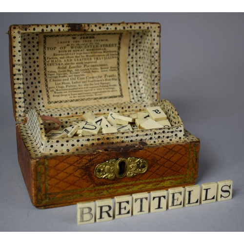 A 19th Century Dome Topped Box in the Form of a Travelling Trunk Containing Bone Alphabetical and Numerical Tiles, Each 1.5cm high