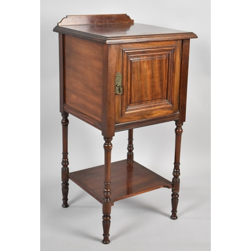 23 - An Edwardian Mahogany Galleried Bedside Cabinet with Panelled Door, Stretcher Shelf and Turned Suppo...