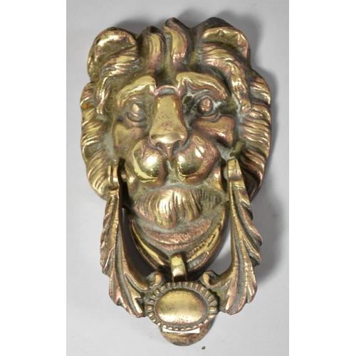 26 - A Nice Quality Cast Brass Lion Mask Door Knocker, 18cm high...