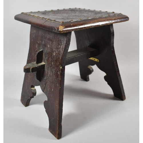 28 - A Square Topped Tooled Leather Mounted Country Stool with Brass Studwork and Armorial Design, 34.5cm...