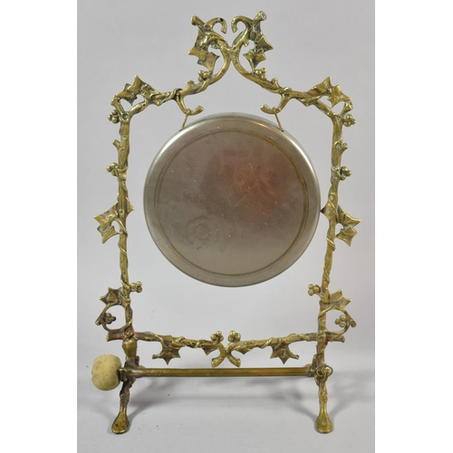 38 - A Brass Table Gong with Clapper, the Frame in the Form of Vine, 36cm High...