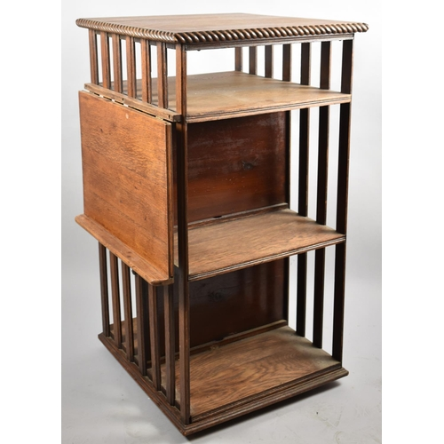 48 - An Edwardian Oak Revolving Bookcase with Hinged Lectern, 93cm high...