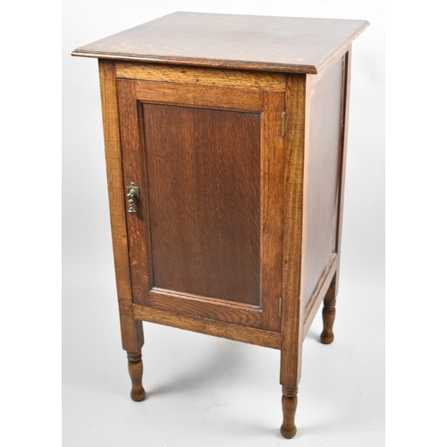 50 - An Edwardian Oak Radio Cabinet with Hinged Lid to Fitted Interior, Panelled Door, 43cm wide...