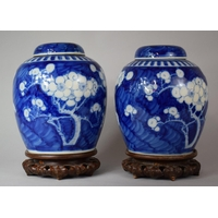 A Good Pair of Large Chinese Prunus Pattern Ginger Jars with Covers on Pierced Wooden Stands, Four Character Mark to One, 33cm high