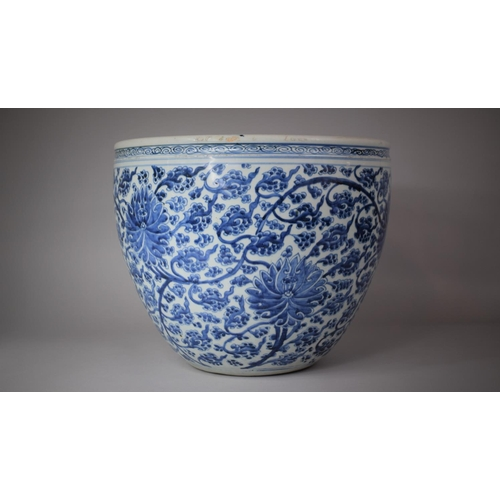 A Large Chinese Qing Dynasty Blue and White Fishbowl Decorated with Chrysanthemums, 37.cm Diameter and 32cm high
